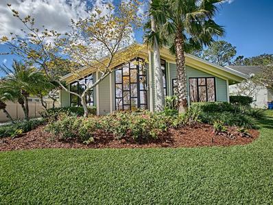 703 N Lakeshore Boulevard, Howey In The Hills, FL 34737 - #: G4853802