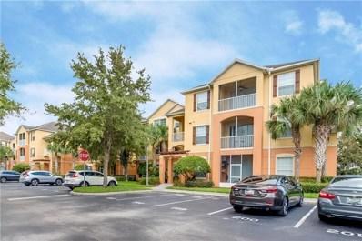 8660 Buccilli Drive UNIT 307, Orlando, FL 32829 - #: O5805849